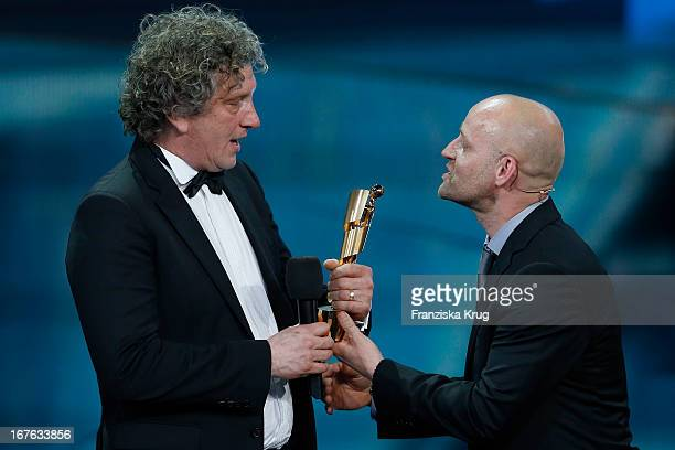 Alexander Berner and Juergen Vogel attend the Lola German Film Award 2013 at FriedrichstadtPalast on April 26 2013 in Berlin Germany