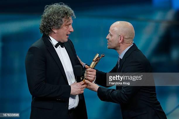 Alexander Berner and Juergen Vogel attend the Lola German Film Award 2013 at Friedrichstadt-Palast on April 26, 2013 in Berlin, Germany.