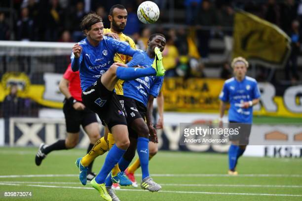 Alexander Berntsson of Halmstad BK and Issam Jebali Aboubakar of IF Elfsborg and Aboubakar Keita of Halmstad BK competes for the ball at Boras Arena...