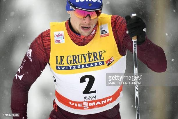Alexander Bessmertnykh of Russia competes in the qualifying of the men's Sprint Classic at the Ruka Nordic World Cup event in Ruka Kuusamo in...
