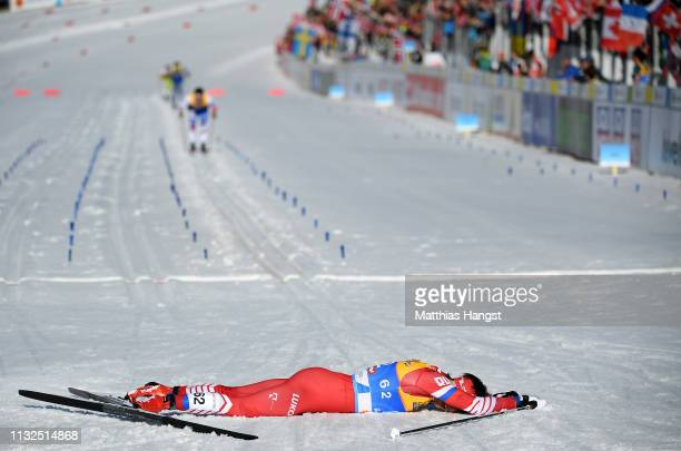 Alexander Bessmertnykh of Russia reacts after he crosses the finish line in the CrossCountry Men's 15k race of the FIS Nordic World Ski Championships...