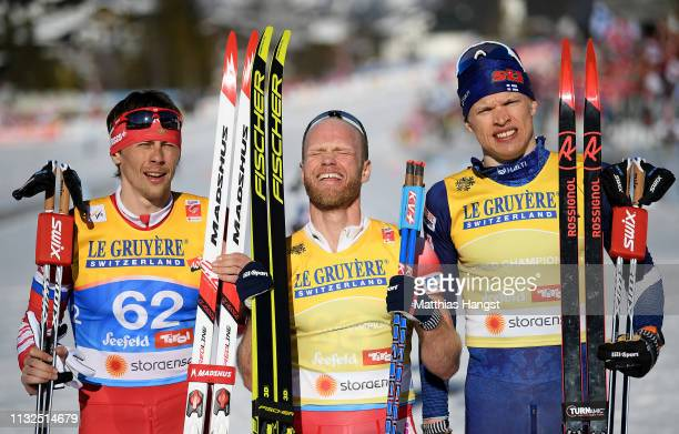 Alexander Bessmertnykh of Russia, silver medal, Johnsrud Marty Sundby of Norway, gold medal and Iivo Niskanen of Finland, bronze medal celebrate...
