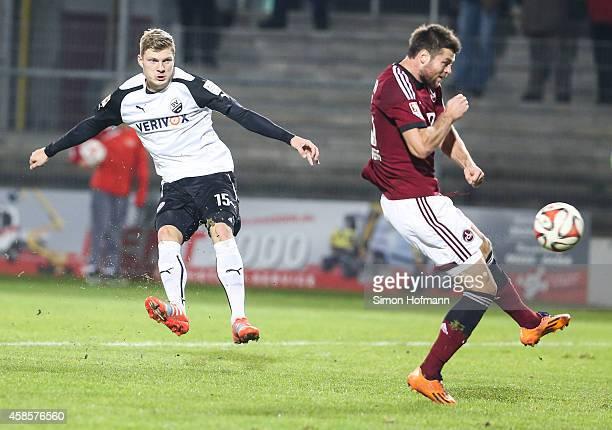 Alexander Bieler of Sandhausen scores his team's first goal against Ondrej Celustka of Nuernberg during the Second Bundesliga match between SV...