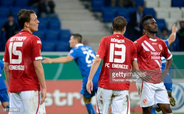 Alexander Bittroff Julian Boerner and Boubacar Sanogo of Cottbus look dejected after Niklas Suehle is scoring his teams opening goal during the DFB...