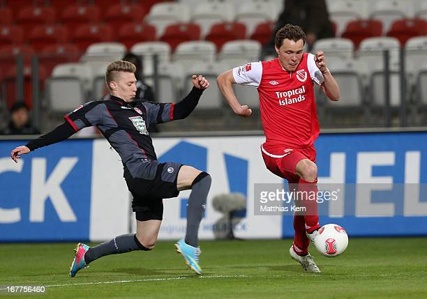 Alexander Bittroff of Cottbus battles for the ball with Mitchell Weiser of Kaiserslautern during the Second Bundesliga match between FC Energie...