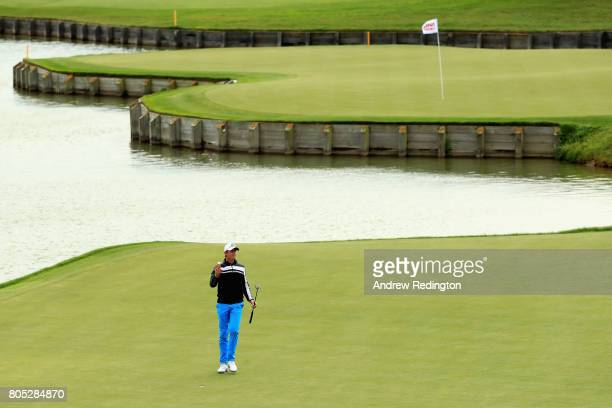 Alexander Bjork of Sweden celebrates as he finishes his round on the 18th green during day three of the HNA Open de France at Le Golf National on...