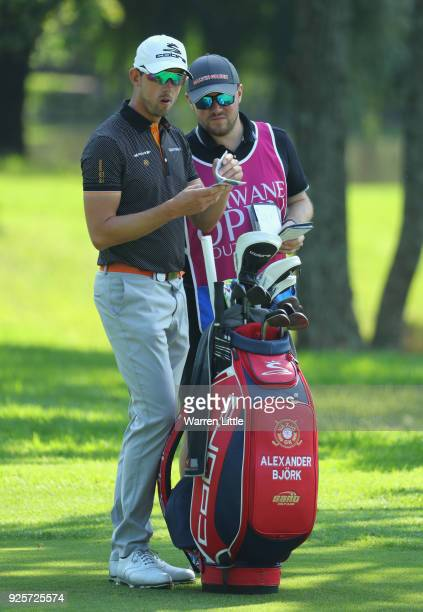 Alexander Bjork of Sweden checks his yardage on the 14th hole during the first round of the Tshwane Open at Pretoria Country Club on March 1 2018 in...