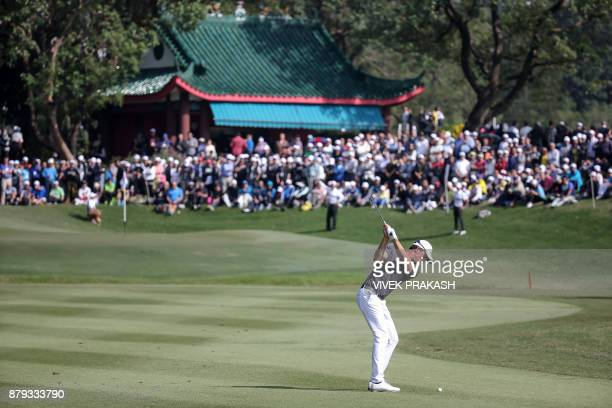 Alexander Bjork of Sweden hits a shot onto the 10th green during the final round of the Hong Kong Open golf tournament at the Hong Kong Golf Club on...