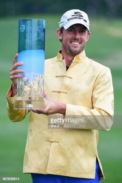 Alexander Bjork of Sweden holds the trophy as he celebrates winning the 2018 Volvo China Open at Topwin Golf and Country Club on April 29 2018 in...