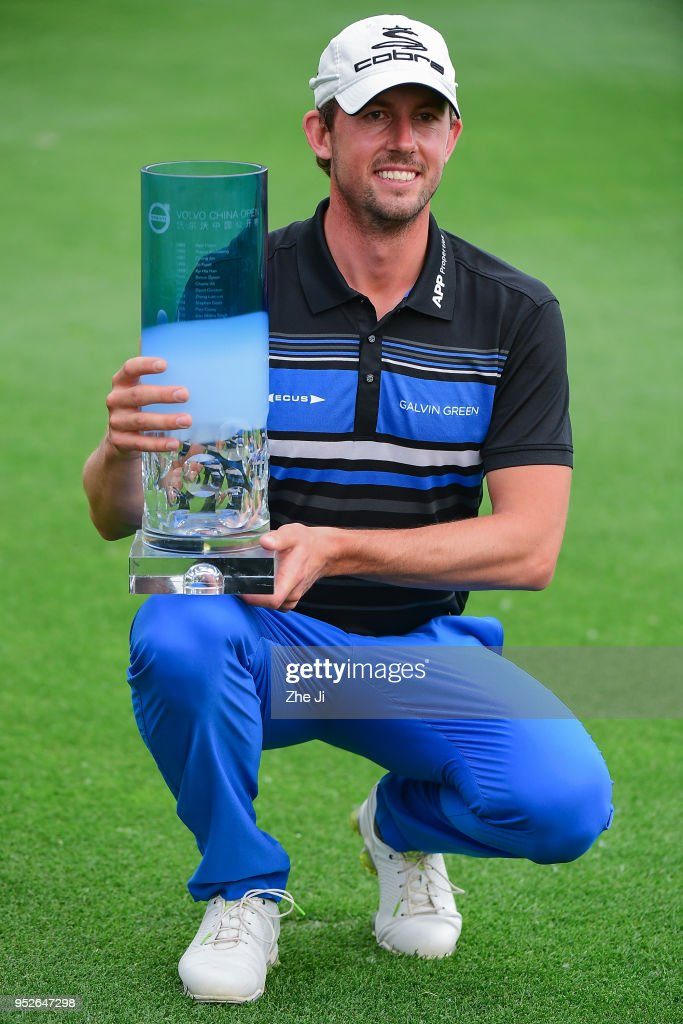 Alexander Bjork of Sweden holds the trophy as he celebrates winning the 2018 Volvo China Open at Topwin Golf and Country Club on April 29, 2018 in Beijing, China.