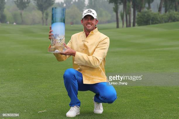 Alexander Bjork of Sweden holds the trophy celebrates after winning the 2018 Volvo China Open at Topwin Golf and Country Club on April 29, 2018 in...