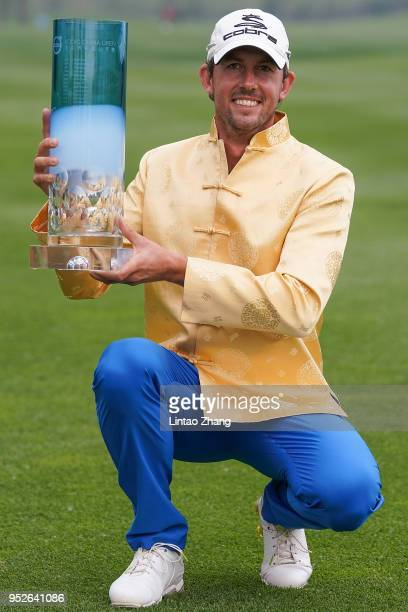 Alexander Bjork of Sweden holds the trophy celebrates after winning the 2018 Volvo China Open at Topwin Golf and Country Club on April 29 2018 in...