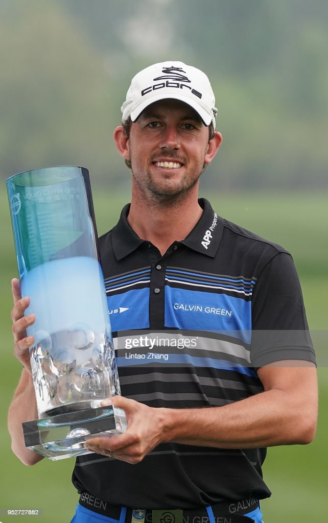 Alexander Bjork of Sweden holds the trophy celebrates after winning the 2018 Volvo China Open at Topwin Golf and Country Club on April 29, 2018 in Beijing, China.