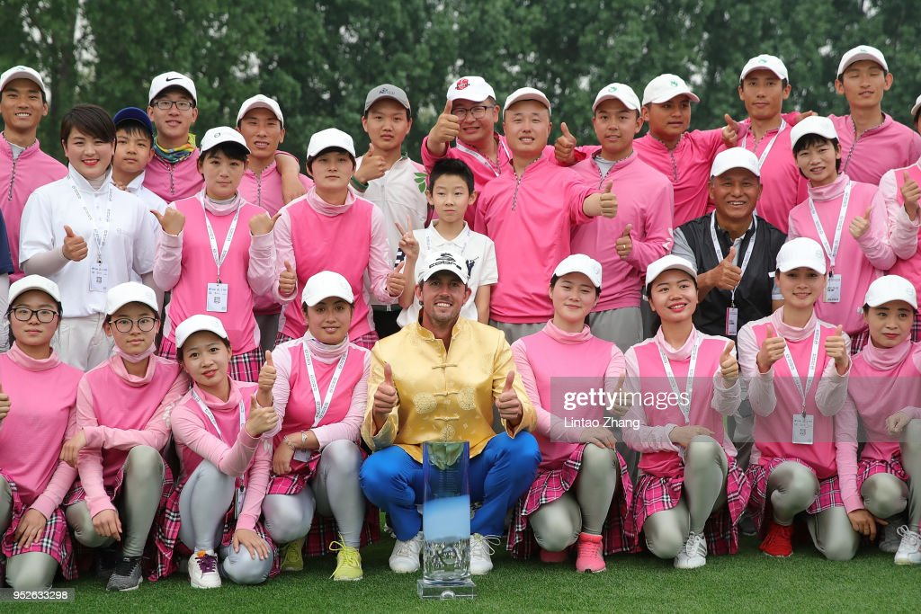 Alexander Bjork (Center) of Sweden holds the trophy with volunteers celebrates after winning the 2018 Volvo China Open at Topwin Golf and Country Club on April 29, 2018 in Beijing, China.