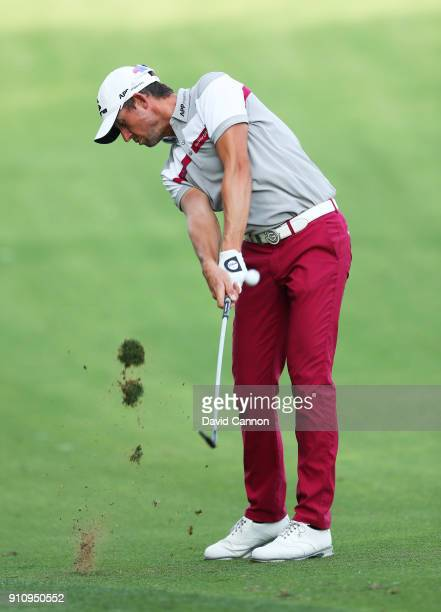 Alexander Bjork of Sweden plays his second shot on the 14th hole during day three of Omega Dubai Desert Classic at Emirates Golf Club on January 27...
