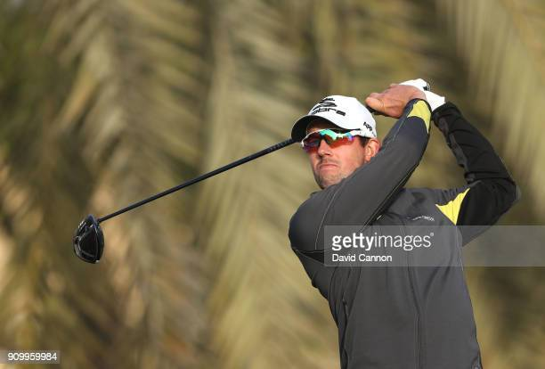 Alexander Bjork of Sweden plays his tee shot on the par 5 third hole during the first round of the Omega Dubai Desert Classic on the Majlis Course at...