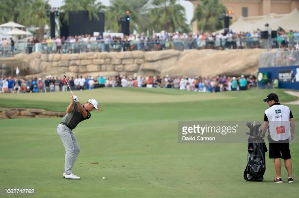 Alexander Bjork of Sweden plays his third shot on the par 5 18th hole during the third round of the DP World Tour Championship on the Earth Course at...