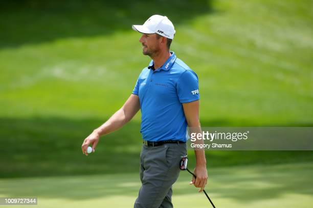 Alexander Bjork of Sweden reacts after making par on the 18th green during World Golf ChampionshipsBridgestone Invitational Round One at Firestone...