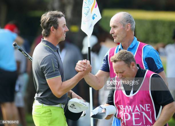 Alexander Bjork of Sweden shakes hands with his father and caddie on the18th green during the third round of the Tshwane Open at Pretoria Country...