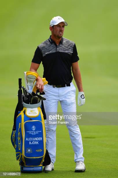 Alexander Bjork of Sweden stands with his bag on the 18th hole during the second round of the 2018 PGA Championship at Bellerive Country Club on...