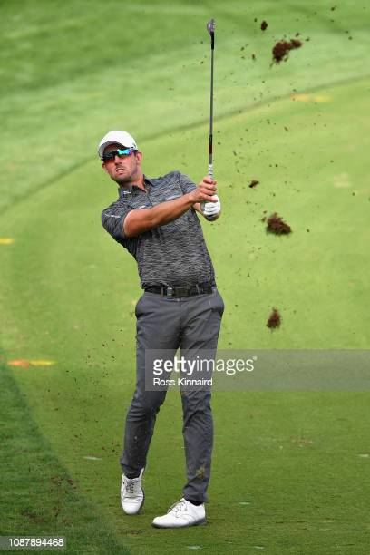 Alexander Bjork of Sweden takes his second shot on hole fourteen during Day One of the Omega Dubai Desert Classic at Emirates Golf Club on January 24...