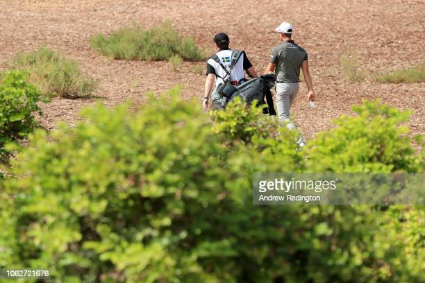 Alexander Bjork of Sweden walks down the 1st hole with his caddie during day three of the DP World Tour Championship at Jumeirah Golf Estates on...