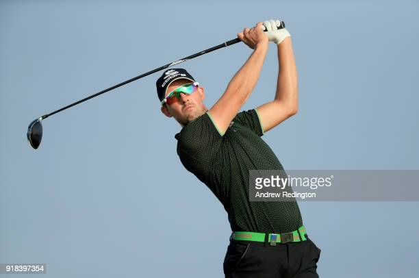 Alexander Bjork of Sweden watches his tee shot on the par five 12th hole during the first round of the NBO Oman Open at Al Mouj Golf on February 15...