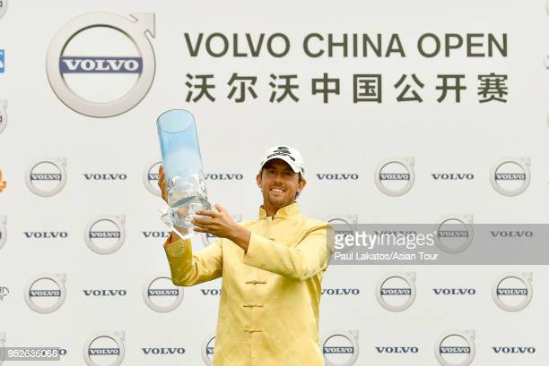 Alexander Bjrk of Sweden pictured withe the winner's trophy at the Topwin Golf and Country Club after the final round of the Volvo China Open on...