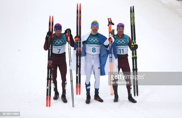 Alexander Bolshunov of Athletes of Russia Iivo Niskanen of Finland and Andrey Larkov of Athletes of Russia are seen during the Men's 50km Mass Start...