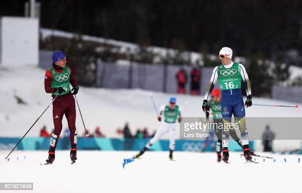 Alexander Bolshunov of Olympic Athlete from Russia and Calle Halfvarsson of Sweden cross the finish line during the Cross Country Men's Team Sprint...