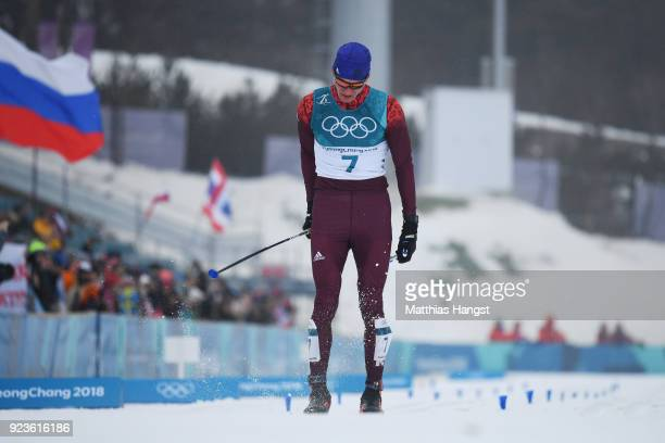 Alexander Bolshunov of Olympic Athlete from Russia reacts after finishing behind Iivo Niskanen of Finland to win the silver medal during the Men's...