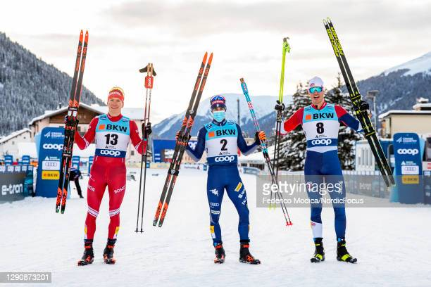 Alexander Bolshunov of Russia , Federico Pellegrino of Italy and Andrew Young of Great Britain pose following the Men's SP F Final at the Coop FIS...