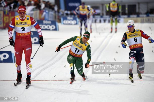 TOPSHOT Alexander Bolshunov of Russia Federico Pellegrino of Italy and Kasper Stadaas of Norway compete in the men's Cross Country Skiing Sprint...