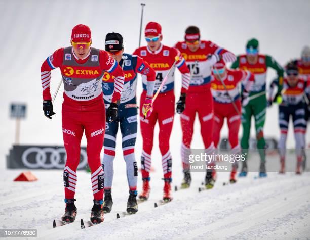 Alexander Bolshunov of Russia Johannes Hostflot Klaebo of Norway during Tour de Ski Men 150 km Mass Start Classic on January 5 2019 in Val di Fiemme...