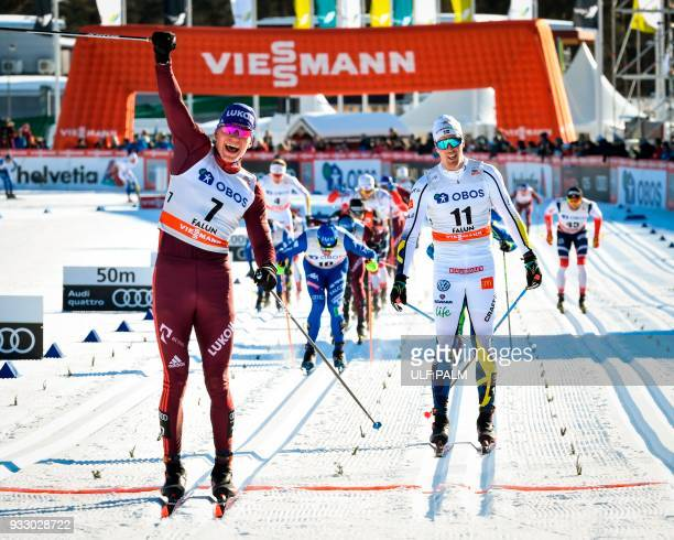 Alexander Bolshunov of Russia reacts after crossing the finish line to win ahead of Sweden's Calle Halfvarsson and Francesco de Fabiani of Italy of...