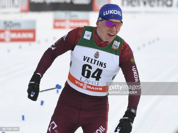 Alexander Bolshunov of Russia reacts in the finish area after placing second in the men' crosscountry skiing 15km classic style event of the FIS...
