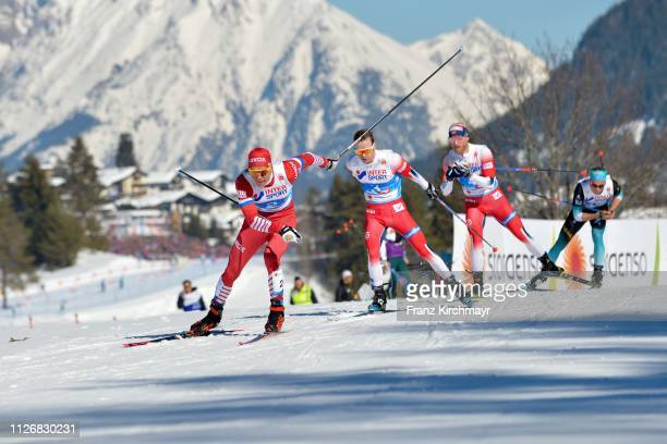 Alexander Bolshunov of Russia Sjur Roethe of Norway and Martin Johnsrud Sundby of Norway during the Men's Cross Country Skiathlon at the FIS Nordic...