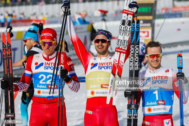 Alexander Bolshunov of Russia takes 2nd place Hans Christer Holund of Norway takes 1st place Sjur Roethe of Norway takes 3rd place during the FIS...