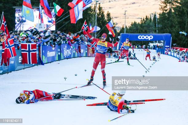 Alexander Bolshunov of Russia takes 3rd place, Simen Hegstad Krueger of Norway takes 1st place, Sjur Roethe of Norway takes 3rd place during the FIS...