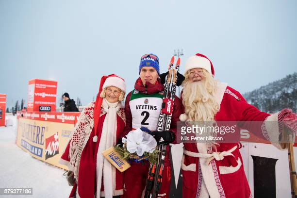 Alexander Bolshunov of Russia with Santa Claus after the mens cross country 15K pursuit competition at FIS World Cup Ruka Nordic season opening at...