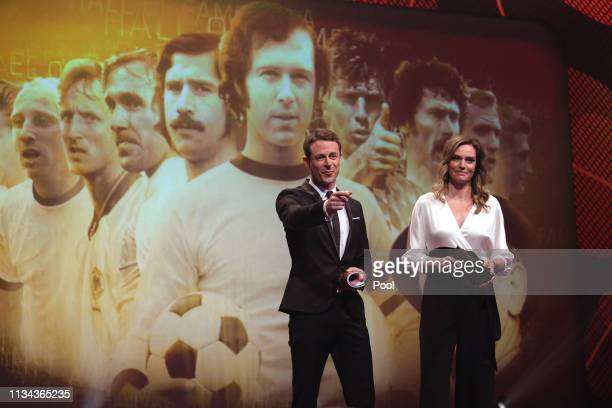 Alexander Bommes and Julia Scharf on stage during the Hall Of Fame gala at Deutsches Fussballmuseum on April 01 2019 in Dortmund Germany