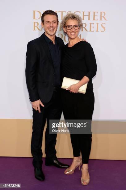 Alexander Bommes and Julia Westlake poses before the 'Deutscher Radiopreis 2014' on September 4 2014 in Hamburg Germany
