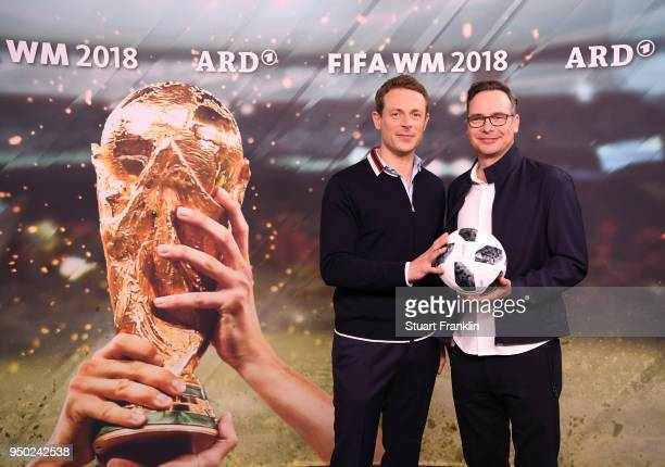 Alexander Bommes and Matthias Opdenhoevel pose for a picture during the ARD and ZDF FIFA World Cup presenter team presentation on April 23 2018 in...