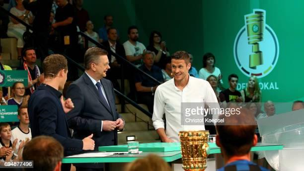 Alexander Bommes ARD moderator Reinhard Grindel DFB president and Sebastian Kehl attend the DFB Cup Draw at Deutsches Fussballmuseum on June 11 2017...