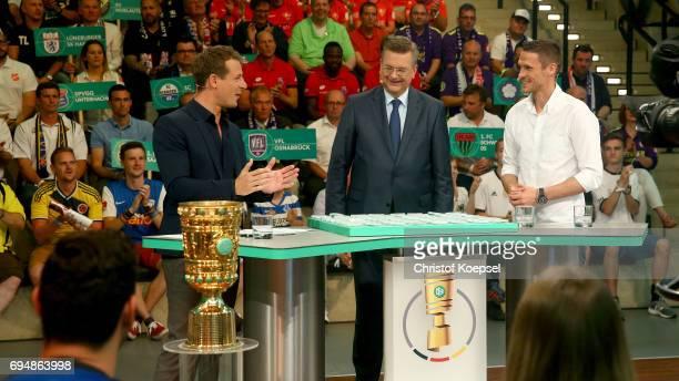 Alexander Bommes ARD moderator Reinhard Grindel DFB presidentn and Sebastian Kehl talkduring the DFB Cup Draw at Deutsches Fussballmuseum on June 11...