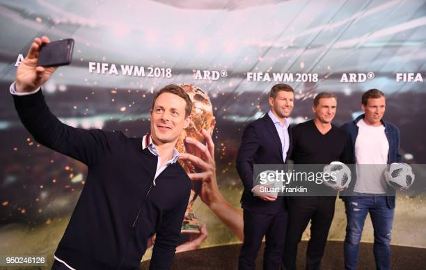 Alexander Bommes makes a selfie as Thomas Hitzlsperger Stefan Kuntz and Hannes Wolf pose for a picture during the ARD and ZDF FIFA World Cup...