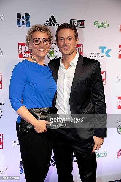 Alexander Bommes with his wife Julia Westlake poses for the media before the Sport Bild Awards at Fischauktionshalle on August 25 2014 in Hamburg...