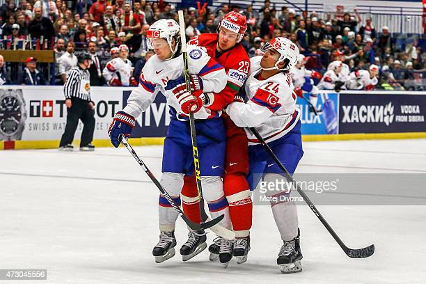 Alexander Bonsaksen and Andreas Martinsen of Norway block Andrei Stas of Belarus during the IIHF World Championship group B match between Norway and...