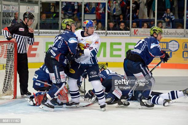 Alexander Bonsaksen of Iserlohn and Michael Wolf of Muenchen battle for the ball during the DEL match between Iserlohn Roosters and EHC Red Bull...