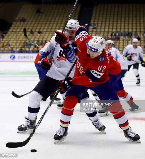 Alexander Bonsaksen of Norway and Chris Kreider of United States battle for the puck during the 2018 IIHF Ice Hockey World Championship Group B game...